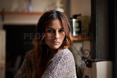 Buy stock photo Portrait of a beautiful young brunette woman sitting in a kitchen bathed in window light