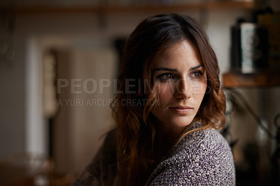 Buy stock photo Head and shoulders shot of a beautiful brunette woman alone in a house