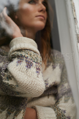 Buy stock photo Shot of a young woman looking out through a rustic farmhouse window