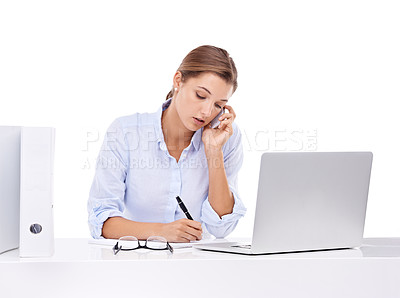 Buy stock photo An attractive young businesswoman talking on the phone and working on her laptop