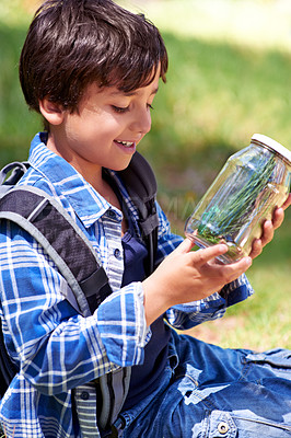 Buy stock photo A young boy playing outside