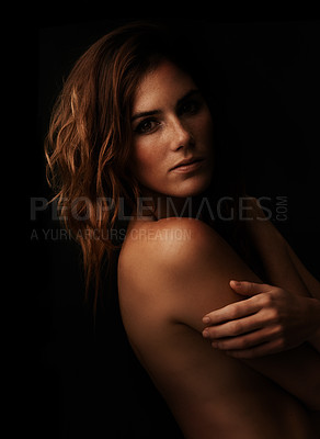 Buy stock photo A beautiful young woman standing naked against a black background
