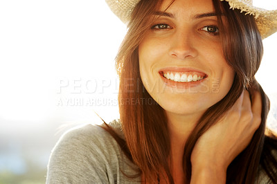 Buy stock photo Pretty young woman wearing a straw hat smiling