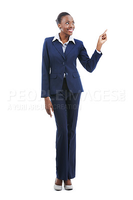Buy stock photo A beautiful young african american businesswoman pointing at copyspace isolated on white