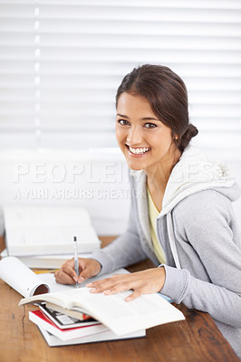 Buy stock photo Portrait of an attractive young student studying for a test in her dorm room