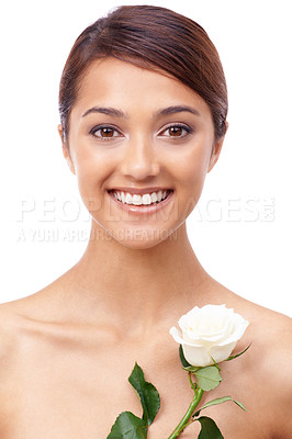 Buy stock photo Portrait of a beautiful young woman with a white rose