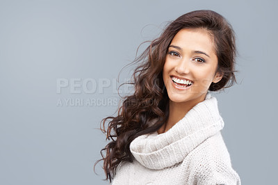 Buy stock photo Pretty woman in winter clothing smiling happily at the camera with copyspace