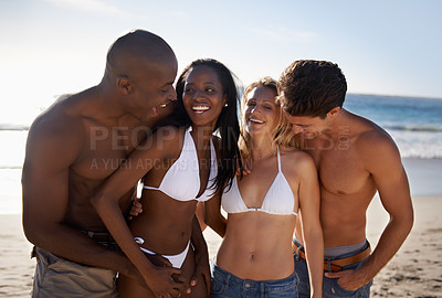 Buy stock photo Two young couples having fun at the beach together
