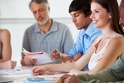 Buy stock photo A gorgeous young brunette involved in an exciting new business project in the boardroom