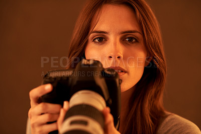 Buy stock photo An attractive young woman with photo camera