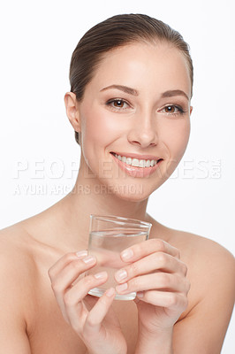 Buy stock photo A beautiful woman with bare shoulders holding a glass of water