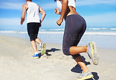Buy stock photo A couple running on the beach
