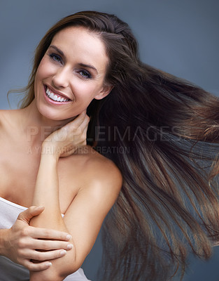 Buy stock photo Portrait of an attractive young woman with long flowing hair