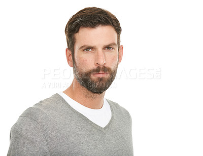 Buy stock photo A young casual man with a serious expression - studio shot
