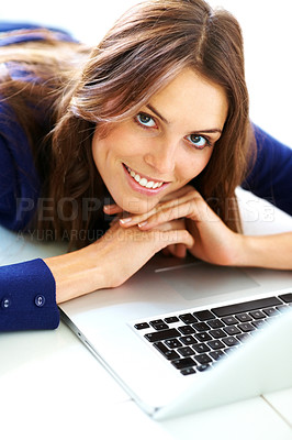Buy stock photo Gorgeous young lady lying down on floor with a lap