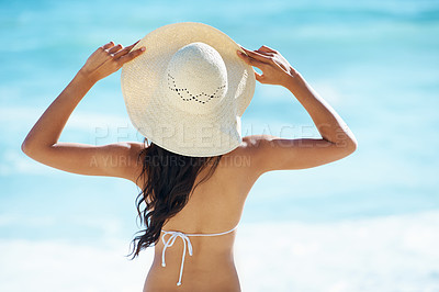 Buy stock photo Rear view of an attractive young woman on the beach