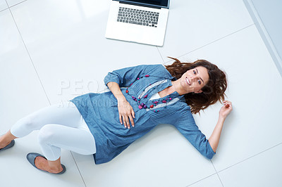Buy stock photo Beautiful young lady relaxing on floor by laptop