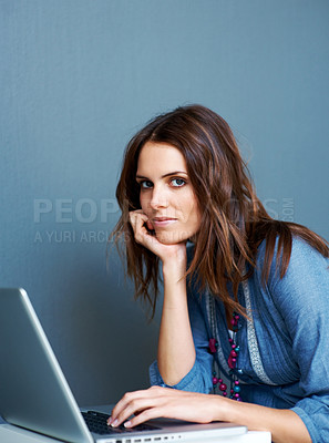 Buy stock photo Beautiful young woman using laptop