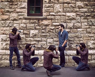 Buy stock photo Multi-exposure shot of a photographer taking pictures of a male model