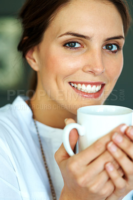 Buy stock photo Happy young woman drinking a cup of coffee