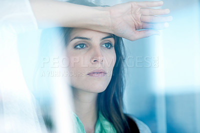 Buy stock photo Lovely young lady looking through glass window