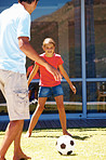 Happy father and daughter playing football together