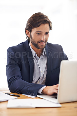 Buy stock photo A handsome businessman  typing on his laptop