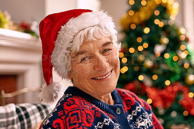 Buy stock photo A senior woman sitting inside wearing a Christmas hat