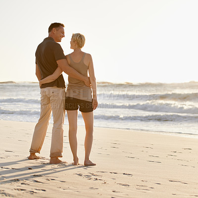 Buy stock photo A loving couple on the beach