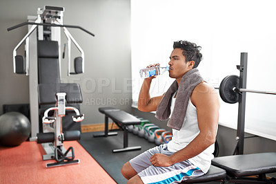 Buy stock photo A young ethnic man exercising in the gym