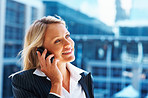 Attractive business woman enjoying conversation on cell phone