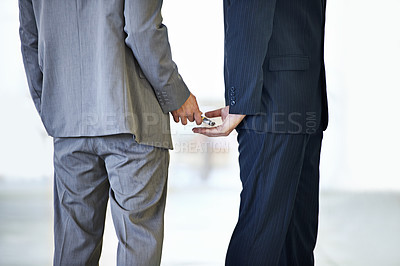Buy stock photo Cropped studio shot of money being placed in a man's hand