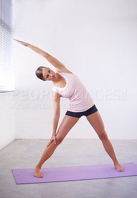 Buy stock photo An attractive young woman in a yoga position