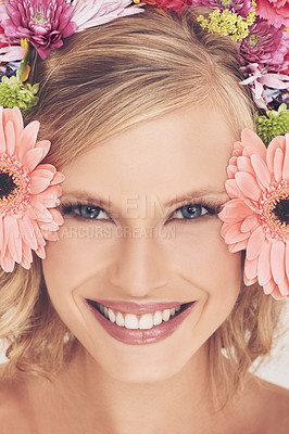 Buy stock photo A young woman with a flower arrangement in her hair smiling at the camera