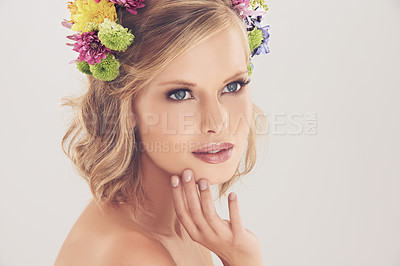 Buy stock photo Studio shot of a beautiful young woman with flowers in her hair