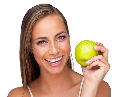 Buy stock photo A young woman smiling while she holds an apple - isolated