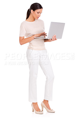 Buy stock photo A woman standing and using her laptop