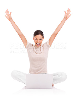 Buy stock photo A young woman sitting with her laptop raising her arms in celebration