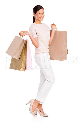 Buy stock photo Full-length studio portrait of an attractive young woman holding shopping bags
