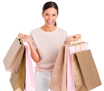 Buy stock photo Cropped studio portrait of an attractive woman holding up shopping bags