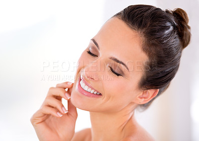 Buy stock photo A beautiful woman caressing her perfect skin