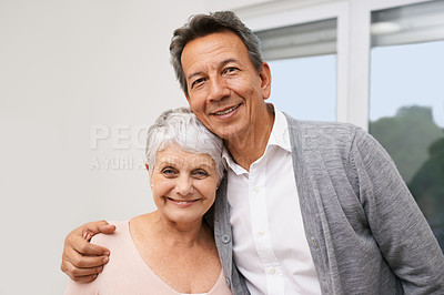Buy stock photo Shot of an affectionate senior couple at home