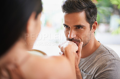 Buy stock photo Shot of a charming man kissing his wife's hand at a restaurant