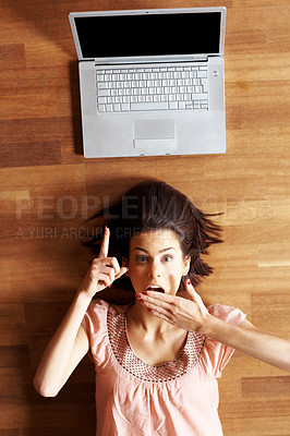 Buy stock photo Surprised - Young female pointing at laptop screen
