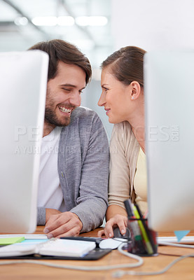 Buy stock photo Shot of a two young business people gazing affectionately at each other
