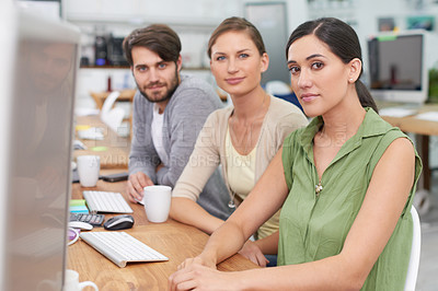 Buy stock photo Shot of a group of young businesspeople looking at the camera