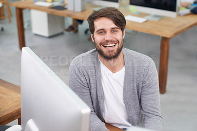 Buy stock photo Portrait of a handsome young man sitting at his office desk