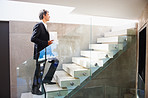 Business man walking up the stairs