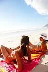 Two hot teenage girls resting on the beach