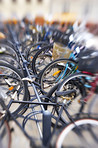 A lens blurred photo of lots of parked bikes. Symbolic content.